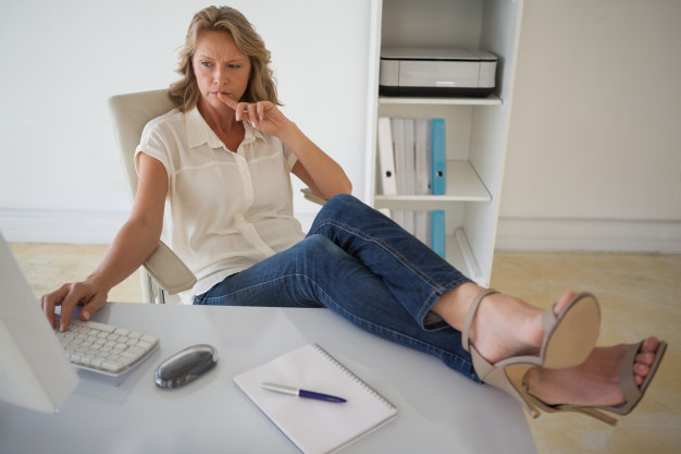 woman working with her feet up on the desk